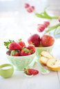 Fresh red fruits and pink tulips Royalty Free Stock Photo