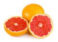 Fresh red grapefruit and juicy isolated on white Stock Photos
