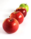 Fresh red and green apples diagonally on white Stock Photo