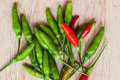 Fresh red and green chilli on old wood background guinea pepper bird bird small capsicum tiny fiery Royalty Free Stock Photos