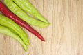 Fresh red and green goat pepper on corner of wood background Royalty Free Stock Photos