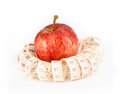 Fresh red juicy apples fruit and measure tape on white backgr for diet background Stock Photos