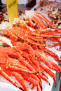 Fresh red king-crab legs in ice at seafood market Royalty Free Stock Images