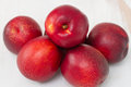 Fresh red nectarines on table Stock Images