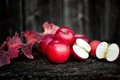 Fresh red organic apples from autumn harvest agriculture harvesting theme with on wooden background Stock Images