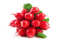 Fresh red radish vegetables with green leaves.