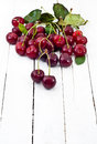 Fresh red ripe cherries on white wood Royalty Free Stock Photo