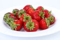 Fresh red ripe strawberries on plate close up Royalty Free Stock Photo