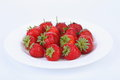 Fresh red ripe strawberries on a white plate see my other works in portfolio Royalty Free Stock Photo