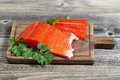 Fresh Red Salmon on Wooden Server Royalty Free Stock Photo
