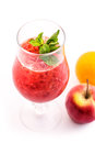 Fresh red smoothie with mint leaf in glass isolated on white background, strawberry, red currant, orange and apple drink, product Royalty Free Stock Photo