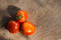 Fresh red tomato from garden on plank Royalty Free Stock Photo