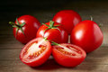 Fresh red tomatoes juicy on wooden table Royalty Free Stock Image