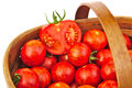 Fresh red tomatoes in wicker basket Royalty Free Stock Photo