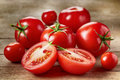 Fresh red tomatoes on wooden table Stock Photos
