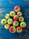 Fresh and ripe apple on blue table wooden top view Stock Images