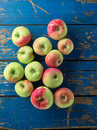 Fresh and ripe apple on blue wooden table top view Royalty Free Stock Image