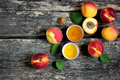 Fresh ripe apricots and apricot oil on old wooden background Royalty Free Stock Photo