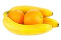 Fresh ripe bananas and orange fruits fruit on white background Stock Photo