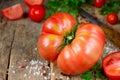 Fresh ripe big red tomato on wood background Royalty Free Stock Photo