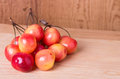 Fresh ripe cherries on wooden table Stock Photo