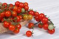 Fresh ripe cherry tomatoes on a plate wooden table Stock Photo