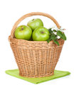 Fresh ripe green apples in basket isolated on white background Stock Photos