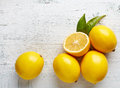 Fresh ripe lemons on wooden table Royalty Free Stock Photo