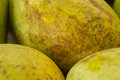 Fresh, ripe mango on a shelf in the market day Royalty Free Stock Photo