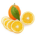 Fresh ripe orange fruits with cut and green leaves isolated Stock Image
