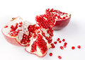 Fresh ripe organic pomegranate fruit on white background exotic excellent source of vitamin Royalty Free Stock Image
