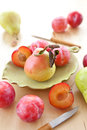 Fresh ripe plums apples pears plate Stock Images