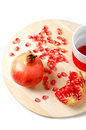 Fresh ripe pomegranate and juice in a cup Royalty Free Stock Photos