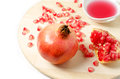 Fresh ripe pomegranate and juice in the small cup Stock Image