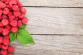 Fresh ripe raspberries on wooden table Royalty Free Stock Photo