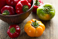 Fresh ripe red, green and yellow paprika peppers Royalty Free Stock Photo