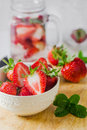 Fresh ripe red strawberries in white bowl Royalty Free Stock Photo