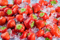 Fresh ripe strawberry with ice fruit background berries Royalty Free Stock Photos