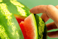 Fresh ripe watermelon hand taking piece of Royalty Free Stock Photography