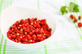Fresh ripe wild strawberries in white bowl as healthy food organic from forest Stock Images