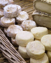 Fresh and ripened goat cheeses on wicker tray small Stock Image