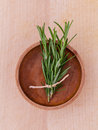 Fresh rosemary herbal medicine in mortar and wooden bowl on wood Royalty Free Stock Photo