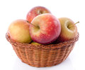 Fresh royal gala apples in a basket isolated on white Stock Photo