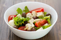 Fresh salad cheese with vegetables in white bowl Royalty Free Stock Photo