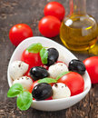 Fresh salad with cherry tomatoes, basil, mozzarella Royalty Free Stock Images