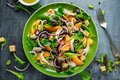 Fresh salad with chicken breast, peach, red onion, croutons and vegetables in a green plate. healthy food Royalty Free Stock Photo
