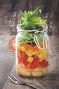 Fresh salad in jar on wood Stock Photography