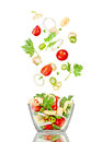 Fresh salad. Mixed falling vegetables Royalty Free Stock Photo