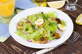 Fresh salad with mushrooms squid and quail eggs Royalty Free Stock Photography