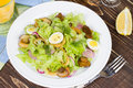 Fresh salad with mushrooms squid and quail eggs Stock Photo